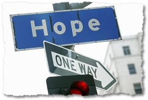 Hope streetsign on same pole as a one way sign